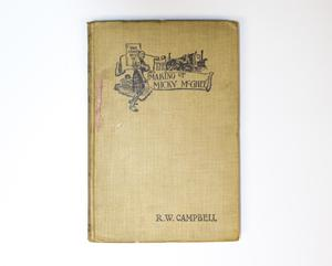A book seen from the front, the author name on the bottom right corner. The top of it is the book title, with a drawing of a few buildings at the top, a man on the left.
