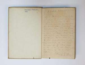 A book open, the page on the left has a nam on the top right corner, the page on the right is covered in pencil writing.