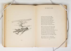 On the page on the left is a drawing of a man laying in grass, the page on the right contains a poem titled No Mans Land.