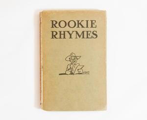 A book with no cover, closed and shown from the cover page. The title Rookie Rhymes is at the top in big letters, under it a drawing of a man in a cowboy hat, a pipe in one hand, and a paper in another.