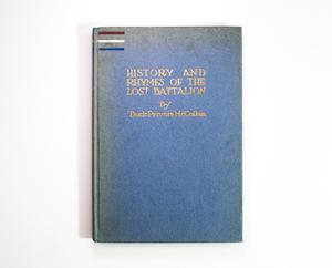 A blue book cover, three lines, red white and blue in the top left corner. In the middle of the top of the cover is the title and author in gold.