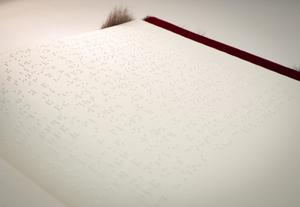 A blank white page with braille covering the whole page.