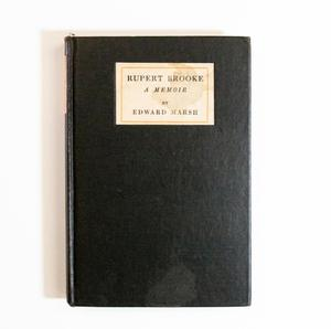 A black book cover. The top of it has a white box with a light stain, the title inside of it.