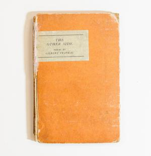 A worn, orange book cover. The title at the top left.