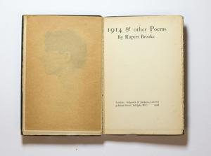 A book open, the left page contains a faded side vie of a mans head. The page on the right is the title page.