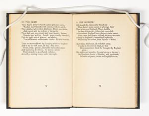 An open book, the page on the contains a poem titled The Dead, and the page on the right has a poem titled The Soldier.