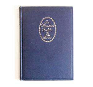 A dark blue book cover, the title at the top in gold letters, inside an oval circle, outlined in gold.