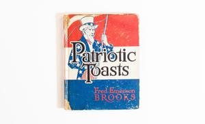 A book cover, the color is red at the top, white in the middle and blue at the bottom. The title is on it in big black letters, an illustration of Uncle Sam on it. The author is on the bottom right in red letters.