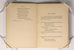Book open to two pages, the on the left with a poem at the top half of the page. The pgae on the right has a poem titled The Answer.