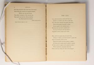 The page on the left has a small amount of text at he top. The page on the right contains a poem titled The Call.