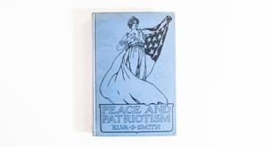 A light blue book, an illustration of a lady wearing the United States Flag on it, at the bottom the title of the book.