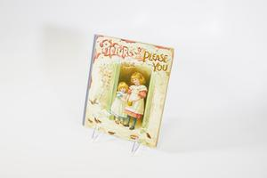 A pale cover containing an illustration of two little girls inside of a doorway with the title at the top.