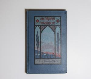 A bright blue book cover. On the front is a box framedin black, the title at the top of it in pink, made to look like a stained glass window.