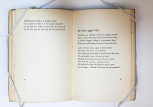 Open book, the page on the left with a bit of text at the top, the page on the right containing a two stanza poem titled The One-Legged Man.
