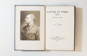 An open book, the page on the left containing a photo of a soldier in uniform. The page on the right is the title page.