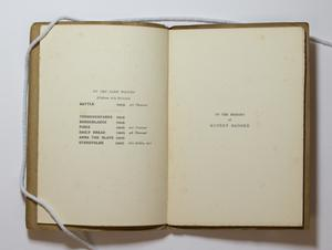 An open book, the page on the left containing an index, the page on the right containing a note To The Memory.