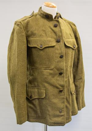 Green wool jacket, several buttons down the middle of it. It has a breast pocket on each side with a button. It also has a button on the collar, and two pockets on each side on the bottom front.