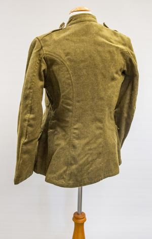 Back of a green wool jacket.