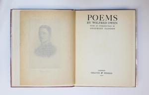 An open book, the page on the left contains a fade photo of a mans face, and the page on the right containing a title page.