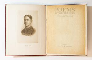 An open book, the page on the left containing a phot of a man in uniform, seen from the shoulders up. The page on the right is the title page.