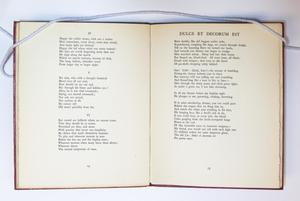 An open book, the page on the left a poem of three sections and the page on the right containing a poem title Dulce at the top.