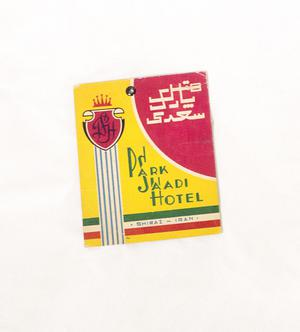 A small yellow decal, red in the top corner. It syas Park Jaadi Hotel on it in green.