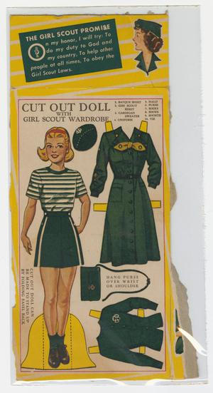 A piece of cardboard with jagged edge like it's been torn. Printed on the board is a color illustration of a girl with blonde hair wearing a white shirt with green horizontal stripes, a green skirt, and brown laced shoes with green socks. To her right are a green beret type of hat, a long green button down dress, with a yellow tie at the collar, a green purse, and a green button down cardigan. The sweater and dress have yellow rectangular tabs at various places around the garment.