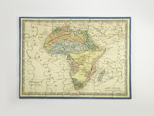 A completed puzzle with a blue border and white background showing a map of Africa with large regions colored either blue, yellow, red, orange, or green, and small text throughout.