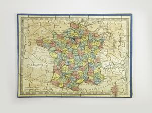 A completed puzzle with a blue border and white background showing a map of France, with small states or regions colored either yellow, red, blue, orange, or green, and small text throughout.
