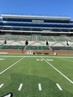 Primary view of object titled '[Apogee Stadium with social distancing seating]'.