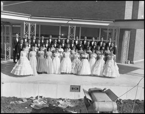 Primary view of object titled '[A Capella Choir Posing for a Photograph on an Outside Stage, November 1960 #3]'.