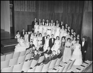 Primary view of object titled '[A Capella Choir Posing for a Photograph in the Corner of the Auditorium, December 4, 1961 #1]'.