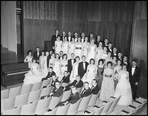 Primary view of object titled '[A Capella Choir Posing for a Photograph in the Corner of the Auditorium, December 4, 1961 #2]'.