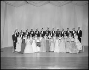 Primary view of object titled '[A Capella Choir Posing on Stage for a Photograph, December 4, 1961 #2]'.