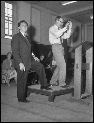 Primary view of object titled '[Frank McKinley on the Conductors Podium, March 26, 1960]'.