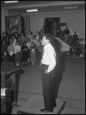 Primary view of object titled '[Frank McKinley receives standing ovation for directing the Grand Chorus, March 26, 1960]'.