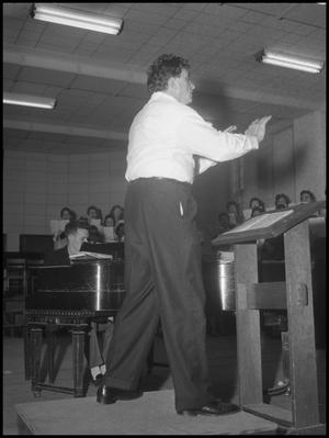Primary view of object titled '[Frank McKinley Conducting the Grand Chorus, March 26, 1960]'.