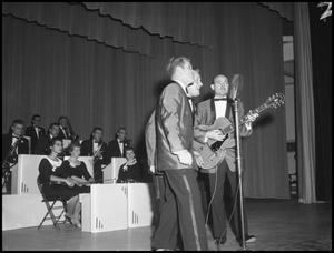 Primary view of object titled '[Singing Group Chuck A Lucks Performing on Stage, December 7, 1957]'.