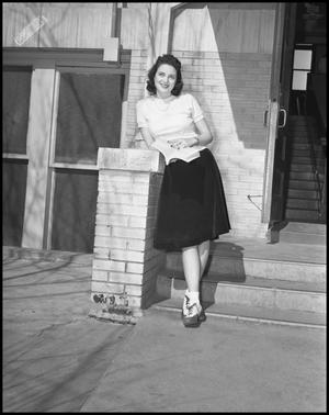 Primary view of object titled '[Female class officer posing next to stairs]'.