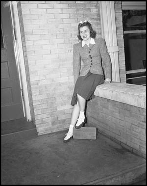 Primary view of object titled '[Female Class Officer Posing Outside of a Building]'.