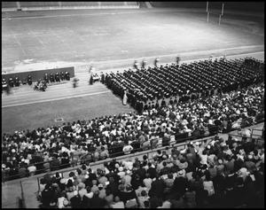 Primary view of object titled '[Commencement - Receiving Diplomas - 1961]'.