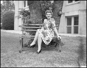 Primary view of object titled '[Virginia Croul Outdoors on a Bench]'.