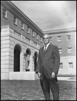 Primary view of object titled 'Curry, O. J. - Business Administration Dept. - Outside Campus Building - Portrait Close Up'.
