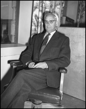 Primary view of object titled '[O. J. Curry Sitting Indoors]'.