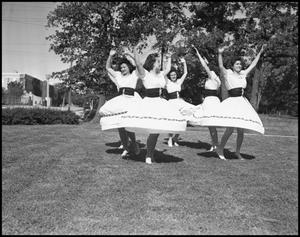 Primary view of object titled '[Five girls dancing on the lawn]'.