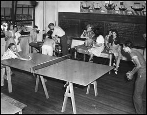 Primary view of object titled '[People recreate in an activity room]'.