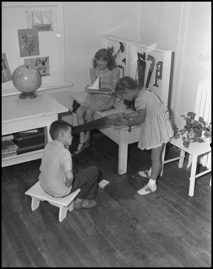 Primary view of object titled '[Children at Workbench]'.