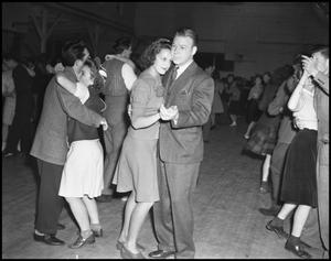 Primary view of object titled '[Couple Dancing at the Duchess of May Fete Informal Dance, 1942]'.