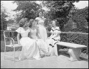 Primary view of object titled '[Four Students Posing Outside for the Duchess of May Fete Informal Dance, 1942]'.