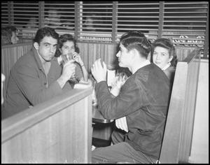Primary view of object titled '[Four Students Eating at Dyche's Corner Restaurant, 1942]'.